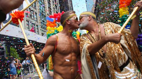 A couple kisses during the WorldPride celebration.