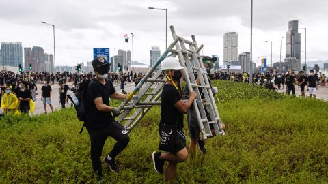Demonstrators carry a barricade during a protest in Hong Kong, China, on Monday, July 1, 2019.