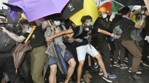 Protesters opposing Hong Kong's now suspended extradition bill face off police on July 1, 2019, near the venue in the central part of the territory of a ceremony the same day to mark the 22nd anniversary of the former British colony's handover to China.