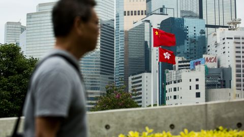 The Chinese and Hong Kong flags are seen outside the Legislative Council in Hong Kong on November 4, 2017.