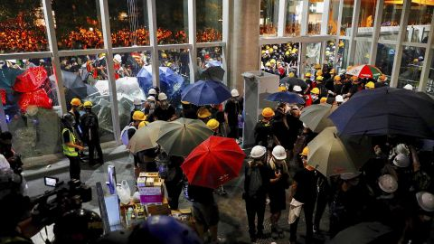 Protesters get inside the Legislative Council after they staged a rally in Hong Kong, Monday, July 1, 2019. Combative protesters are staging a protest outside the Hong Kong legislature as a crowd of thousands prepares to start a march in that direction.(AP Photo/Vincent Yu)