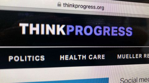 A photo of a computer screen showing the Thinkprogress site.