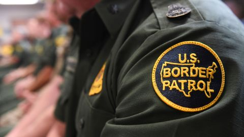 A US Customs and Border patrol agent looks on as US President Donald Trump speaks during  a roundtable on immigration and border security at the US Border Patrol Calexico Station in Calexico, California, April 5, 2019. - President Donald Trump landed in California to view newly built fencing on the Mexican border, even as he retreated from a threat to shut the frontier over what he says is an out-of-control influx of migrants and drugs. (Photo by SAUL LOEB / AFP)        (Photo credit should read SAUL LOEB/AFP/Getty Images)