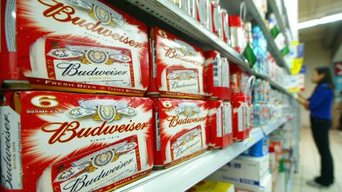 SHANGHAI, CHINA:  Packs of US brand Budweiser beers are displayed in a Shanghai's supermarket, 20 October 2004.  US-based Anheuser-Busch, the world's largest brewer and the maker of Budweiser, may pay up to one billi