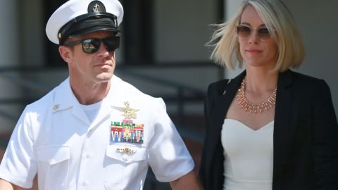 Navy SEAL Edward Gallagher leaves military court in San Diego with his wife Andrea Gallagher on Tuesday.