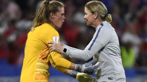 Ellis celebrates with goalkeeper Alyssa Naeher after the semifinal against England.