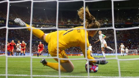 """US goalkeeper Alyssa Naeher <a href=""""https://www.cnn.com/2019/07/02/us/alyssa-naeher-uswnt-trnd/index.html"""" target=""""_blank"""">saves a penalty</a> by England's Steph Houghton late in the semifinal. The goal preserved the Americans' 2-1 lead."""