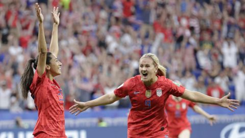 Christen Press, left, celebrates her opening goal against England with Lindsey Horan. Press was the surprise starter in place of Rapinoe.