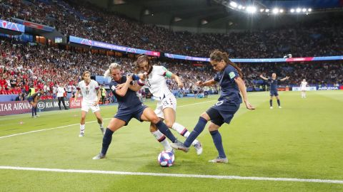 Morgan is challenged by French players Amandine Henry, left, and Amel Majri.