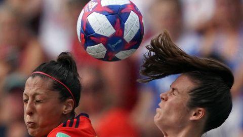 Spanish forward Jennifer Hermoso and US defender Kelley O'Hara compete for a header.