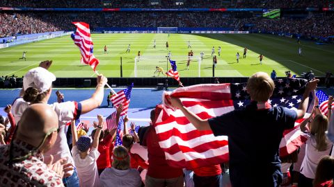 US fans celebrate a goal in the Americans' 3-0 victory over Chile. Thousands of US fans made the trip to France.