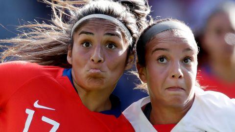 Chile's Javiera Tora, left, and US midfielder Mallory Pugh focus on the ball.