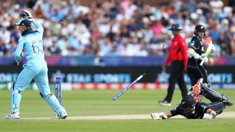 Ross Taylor of New Zealand is run out as Jos Buttler breaks the stumps after a throw from Adil Rashid.