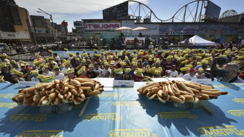 Fans wear themed foam hats as they attend the 2019 Nathan's Famous Fourth of July Hot Dog Eating Contest in Brooklyn. (Photo by Anthony Behar/Sipa USA)(Sipa via AP Images)