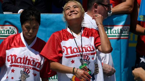 Miki Sudo, right, ate 31 hot dogs to win the women's competition. (AP Photo/Sarah Stier)