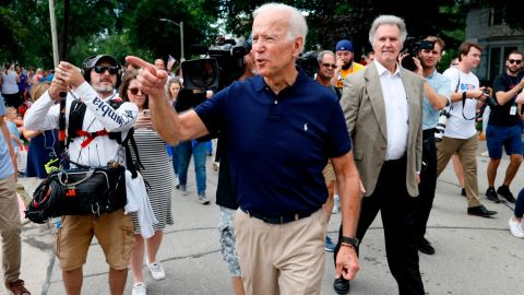 Former vice president and Democratic presidential candidate Joe Biden greets local residents while walking in the Independence Fourth of July parade, Thursday, July 4, 2019, in Independence, Iowa. (AP Photo/Charlie Neibergall)