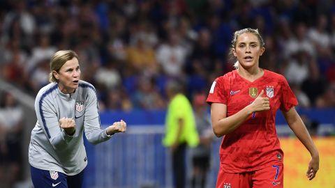 Ellis speaks to defender Abby Dahlkemper during the semi-final against England.
