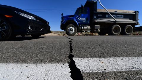 Vehicles drive over a crack on Highway 178 south of Trona, after a 6.4-magnitude earthquake hit in Ridgecrest, California, on July 4, 2019.