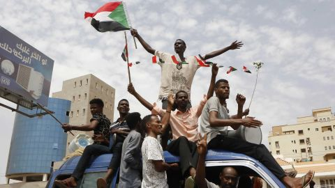 Sudanese protesters celebrate in the streets of the capital, Khartoum, after ruling generals and protest leaders announced they have reached an agreement on a new governing body Friday.