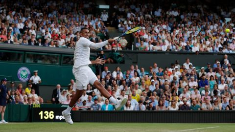 Nick Kyrgios fires a forehand against Rafael Nadal on Centre Court.