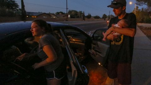 Davia and Peyton Speed and their 1-month-old daughter Lillian get into their car for safety after the earthquake in Ridgecrest.