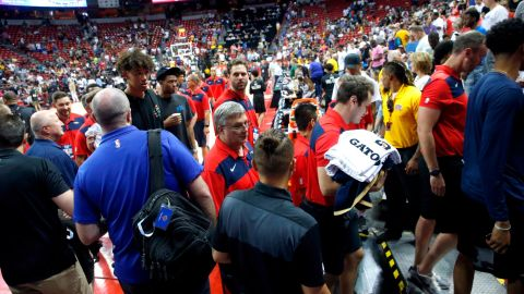 Players and staff leave the court after an earthquake during an NBA summer league basketball game between the New York Knicks and the New Orleans Pelicans on Friday in Las Vegas.