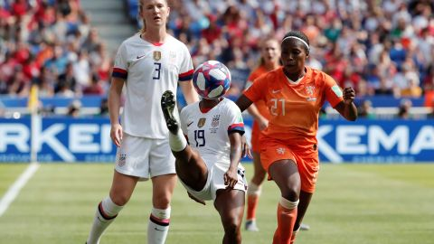 US defender Crystal Dunn plays a ball in the first half.