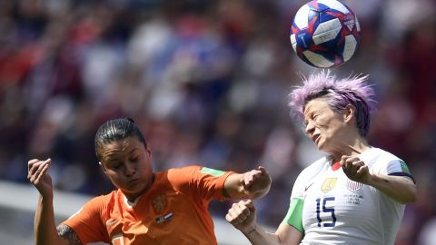 Rapinoe connects on a header.