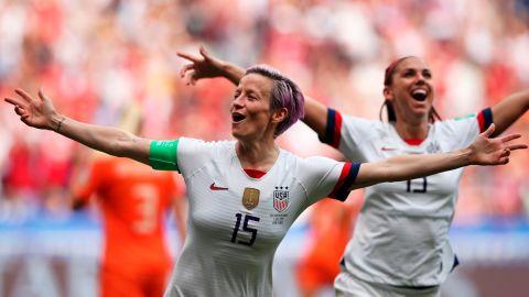 Megan Rapinoe celebrates after scoring the opening goal in Sunday's game