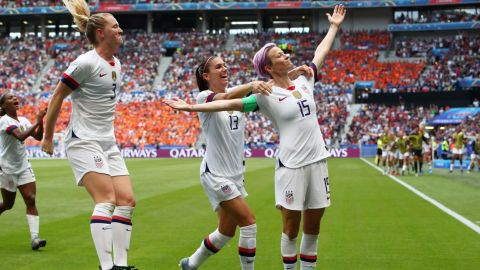 US captain Megan Rapinoe, right, celebrates with teammates after scoring the opening goal of the final. She converted a penalty in the 61st minute.