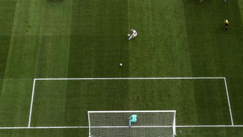 Rapinoe takes a penalty awarded in the second half for a foul on Alex Morgan.