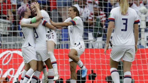 Rose Lavelle, third from left, celebrates after adding the team's second goal in the 69th minute.