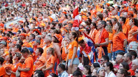 Dutch fans watch the match from inside the stadium.