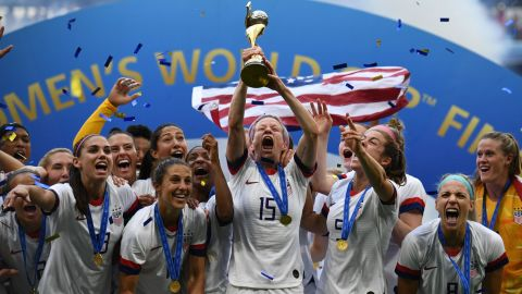 USA's players including forward Megan Rapinoe (C) celebrate with the trophy after the France 2019 Womens World Cup football final match between USA and the Netherlands, on July 7, 2019, at the Lyon Stadium in Lyon, central-eastern France. (Photo by FRANCK FIFE / AFP)        (Photo credit should read FRANCK FIFE/AFP/Getty Images)