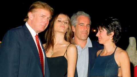 Jeffrey Epstein (second from right) posed with Donald Trump, Melania Trump and British socialite Ghislaine Maxwell at the Mar-a-Lago club in Palm Beach, Florida, February 12, 2000.