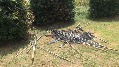 The remains of the flags were found in a pile, the funeral home says.