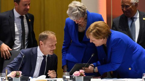 Merkel talks with European Council President Donald Tusk and British Prime Minister Theresa May at a roundtable meeting in Brussels, Belgium, in April 2019. May was in Brussels to formally present her case for a short Brexit delay.