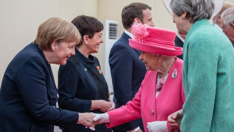 Britain's Queen Elizabeth II, accompanied by Prime Minister Theresa May, greets Merkel in Portsmouth, England, in June 2019. It was ahead of an event marking the 75th anniversary of the D-Day invasion.