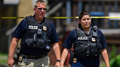 Officers on Tuesday work at the crime scene where several bodies were found.