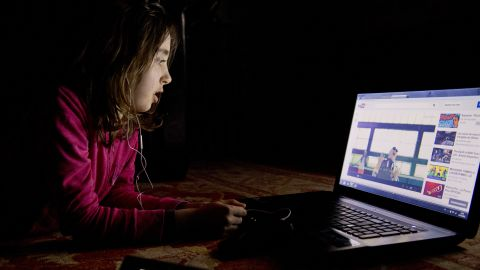 A girl watches a video on youtube on a computer on February 27, 2013 in Chisseaux near Tours, central France.  AFP PHOTO/ ALAIN JOCARD        (Photo credit should read ALAIN JOCARD/AFP/Getty Images)
