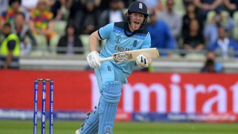 England's captain Eoin Morgan hits the winning runs as he celebrates victory against Australia.