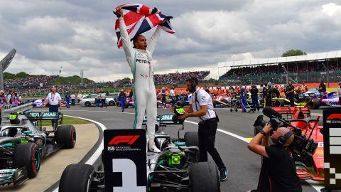 Lewis Hamilton celebrates a record sixth British Grand Prix.