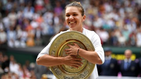 Simona Halep of Romania poses for a photo with the trophy after winning the Ladies' Singles final against Serena Williams of The United States during Day twelve of The Championships - Wimbledon 2019 at All England Lawn Tennis and Croquet Club on July 13, 2019, in London, England.