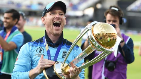 England's captain Eoin Morgan celebrates with the World Cup trophy.