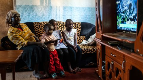 StarTimes subscriber Purity Njambi (34) watches television with her children [left to right] James Ngugi (3), Margaret Wahu (8) and Agnes Wambui (8), in their home in Ndumbuini village on the outskirts of Kenya's capital Nairobi, on April 5, 2019. In Africa, for decades TV was a privilege of the elite. The arrival of Chinese start-up StarTimes in 2002 changed that in Kenya by slashing TV installation charges from $200 to $10, and charging $1 a month for 10 channels. In short, StarTimes brought TV to the masses. Its service spread across the continent. Today, Kenyan viewers watch Chinese Qing dynasty dramas and the Chinese Super League over dinner. Crucially, the news is told from a Chinese perspective by state media such as CGTN. In 2009, China said it was dedicating $7 billion to state-owned media abroad, as part of its soft power drive. StarTimes has helped that mission.