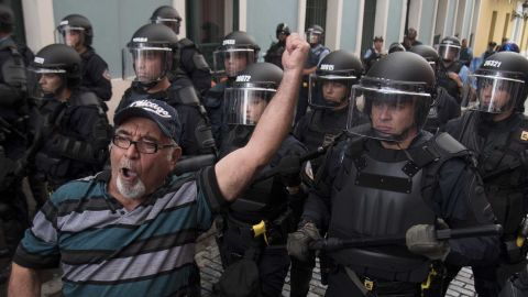 Police block demonstrators from advancing to La Fortaleza governor's residence in San Juan Sunday.