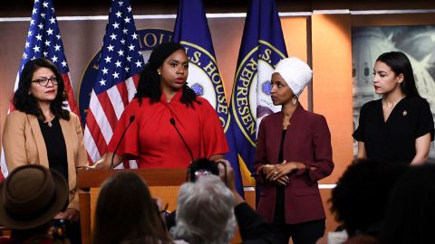 """US Representatives Ayanna Pressley (D-MA) speaks as, Ilhan Omar (D-MN)(2R), Rashida Tlaib (D-MI) (R), and Alexandria Ocasio-Cortez (D-NY) look on during a press conference, to address remarks made by US President Donald Trump earlier in the day, at the US Capitol in Washington, DC on July 15, 2019. - President Donald Trump stepped up his attacks on four progressive Democratic congresswomen, saying if they're not happy in the United States """"they can leave."""" (Photo by Brendan Smialowski / AFP)        (Photo credit should read BRENDAN SMIALOWSKI/AFP/Getty Images)"""