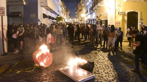 Protesters filling the street in front of the governor's mansion in Old San Juan clashed with police.