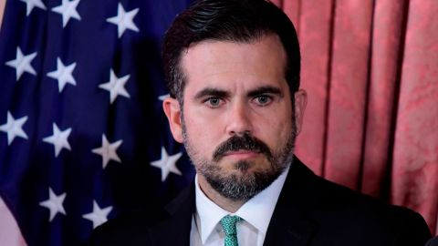 Puerto Rico Gov. Ricardo Rossello attends a press conference in La Fortaleza's Tea Room, in San Juan, Puerto Rico, Tuesday, July 16, 2019. Rossello summoned the press a few hours after a riot took place near the executive mansion, where protesters demanded Rossello step down after a leak of profanity-laced and at times misogynistic online chat with nine other male members of his administration. (AP Photo/Carlos Giusti)