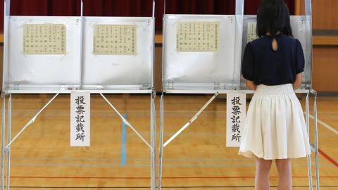 HIMEJI, JAPAN - JULY 10: An eighteen year old young woman casts her vote for parliament's upper house election at a polling station on July 10, 2016 in Himeji, Japan. Japan went to vote Sunday to select half of the 242 seats in the upper house of parliament. If Prime Minister Shinzo Abe's Liberal Democratic Party earns the two-thirds majority in the upper house, in theory, it will give the LDP enough votes to realize PM Abe's idea of revising Japan's constitution, including the restriction on the roles of Japan Self-Defense Force. (Photo by Buddhika Weerasinghe/Getty Images)